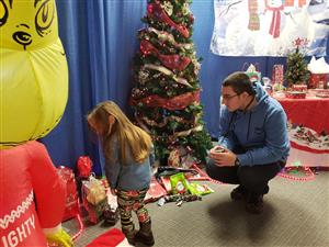 Student chooses gift from under tree